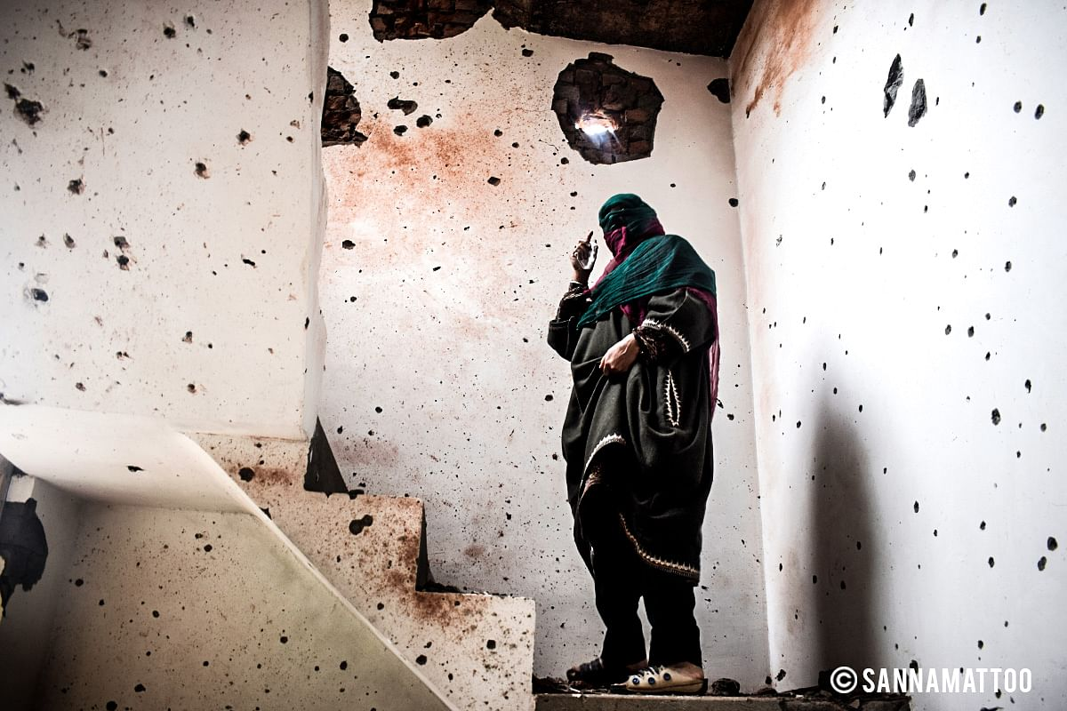 After the Chattabal encounter that killed three militants and a civilian, a woman looks at her house that also became a casualty on 5 May 2018.