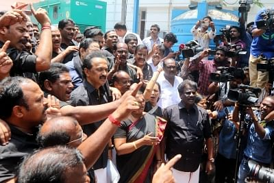 Chennai: DMK working president MK Stalin and party workers stage a demonstration wearing black clothes, against the death of 13 people who lost their lives in police firing during anti-Sterlite protests, at the state assembly in Chennai on May 29, 2018. The Tamil Nadu government on Monday issued orders closing the copper smelter plant in Thoothukudi owned by the Vedanta Group, a week after 13 people were killed in police firing during protests against the continued functioning of the unit. (Phot