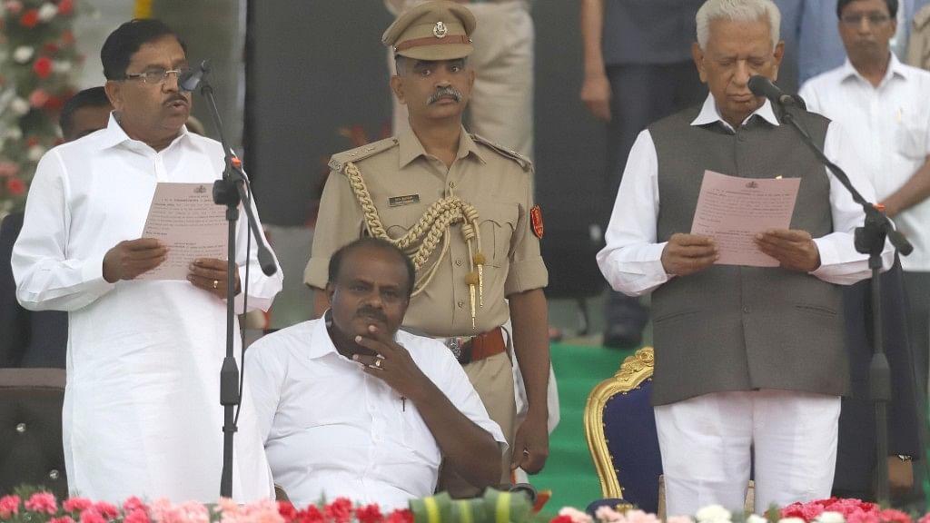 Karnataka Governor Vajubhai Vala administers the oath of office to Congress leader G Parameshwara, during a swearing-in ceremony at Vidhana Soudha in Bengaluru on 23 May.