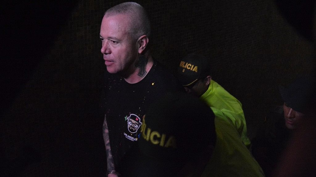 Jhon Jairo Velazquez, a former hitman of the late drug lord Pablo Escobar, arrives escorted by police, for a hearing at a court in Medellin, Colombia.