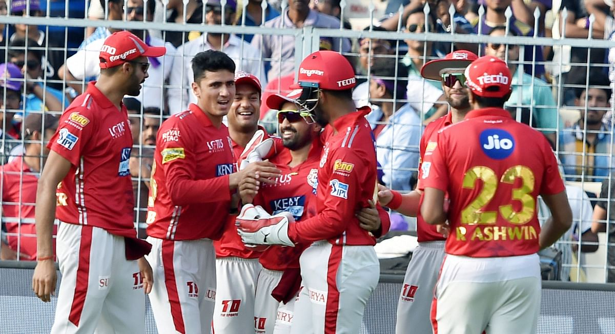 Mujeeb Ur Rahman celebrates a wicket with his former Kings XI Punjab team-mates.