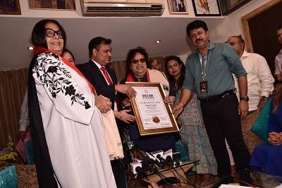 Mumbai: Singer Bappi Lahiri being honored by the World Book of Records, London (UK) in Mumbai on May 1, 2018. (Photo: IANS)