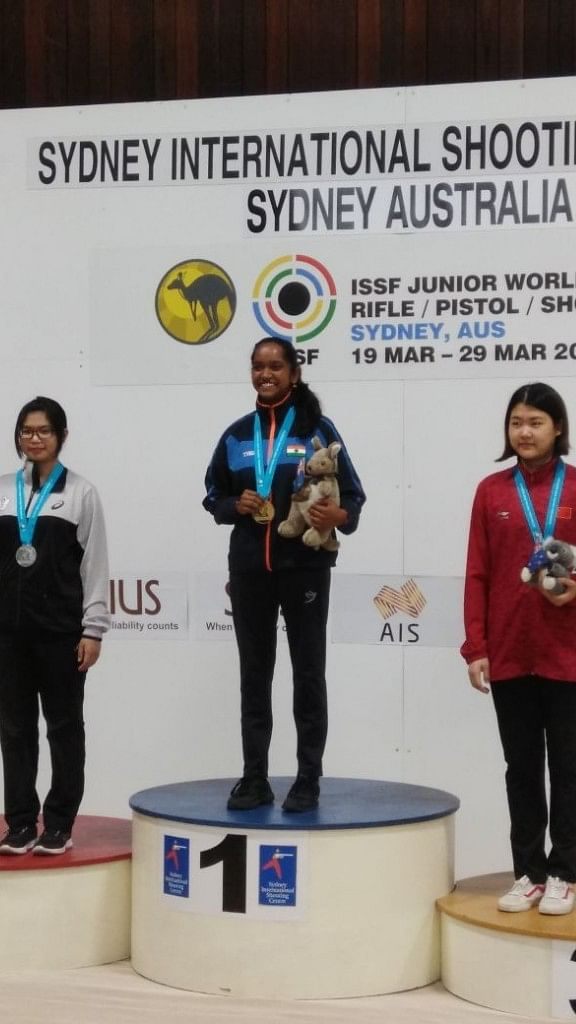 Valarivan after winning gold at in the 10M Air Rifle Shooting event.