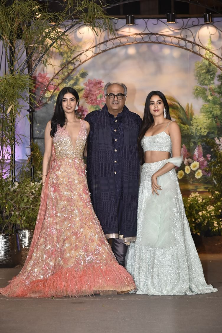 Janhvi and Khushi Kapoor pose with their father.
