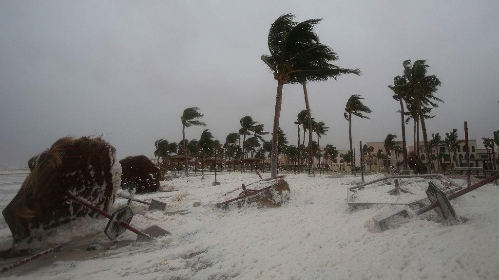 Debris and sea foam litter a beach after Cyclone Mekunu in Salalah, Oman, Saturday, 26 May.