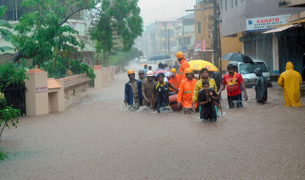 School students being led by NDRF team personnel in Mangaluru