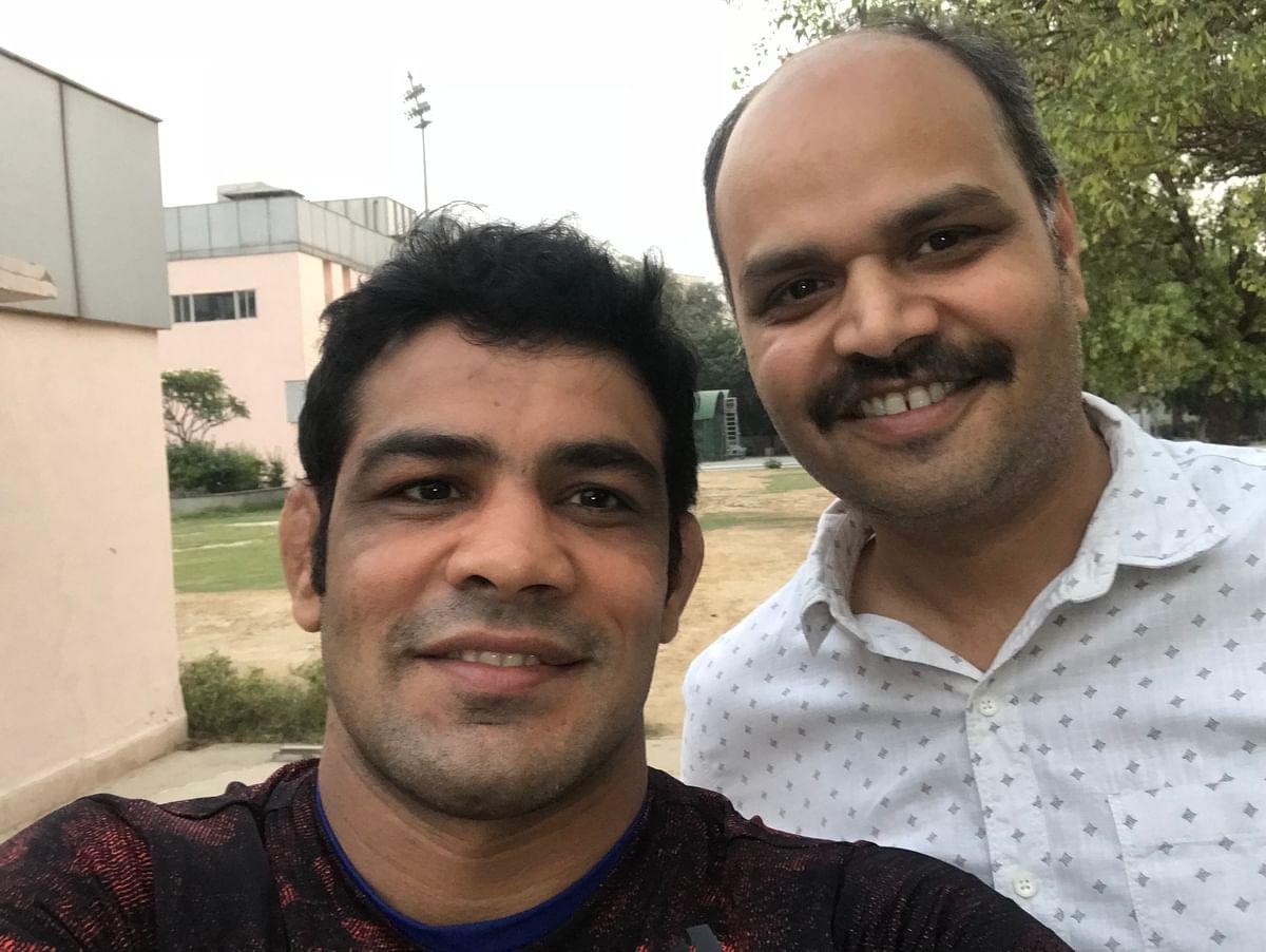 Sushil Kumar with the sports journalist Shivendra Kumar Singh.