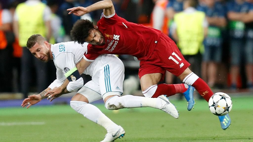 Ramos had grabbed Salah chasing the ball and held on to his right arm and in their twisting fall, the Egypt forward landed heavily on his left shoulder.