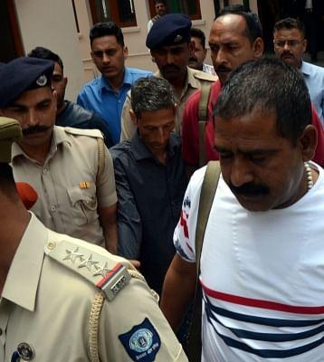Kasauli: Police take away Vijay Singh, the owner of the Narayani Guest House in Himachal Pradesh