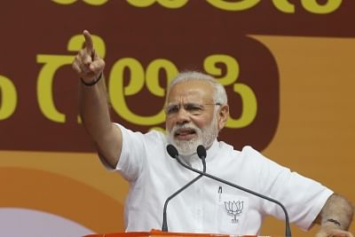 Bengaluru: Prime Minister and BJP leader Narendra Modi addresses during a BJP rally ahead of Karnataka Assembly Polls at Kengeri, near Bengaluru on May 3, 2018. (Photo: IANS)