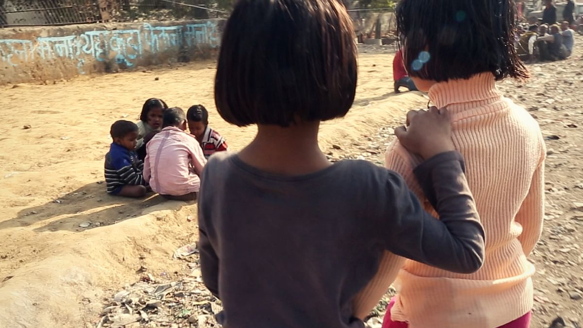 A photo of 6-year-old rape survivor Chhoti Nirbhaya (R) with her older sister.
