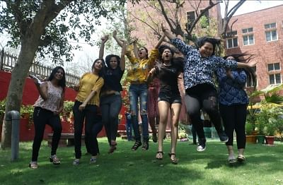 New Delhi: Students celebrate after the Central Board of Secondary Education (CBSE) declared results of the class 12 examinations, in New Delhi on May 26, 2018. (Photo: IANS)