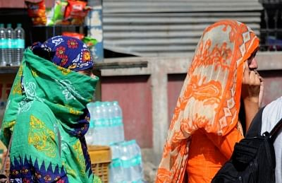 Amritsar: Women cover their head to protect themselves from the scorching sun on a hot sunny day, in Amritsar on May 23, 2018. (Photo: IANS)