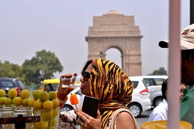 New Delhi: Women cover themselves to avoid scorching sun on a hot day in New Delhi. (Photo: IANS)