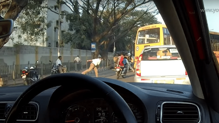 The constable was spotted throwing his shoe at the riders in Bangalore's BEL Road.