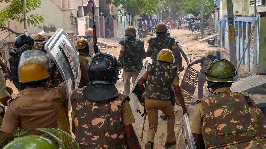 Police personnel tackles agitators in Tamil Nadu's Tuticorin.