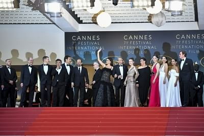 """CANNES, May 8, 2018 (Xinhua) -- Staff of the film """"Everybody Knows"""" attend the screening of """"Everybody Knows"""" and the opening gala of the 71st Cannes International Film Festival at Palais des Festivals in Cannes, France, on May 8, 2018. The 71st Cannes International Film Festival rose its curtain on Tuesday with a gathering of movie industry professionals and cinema stars headed from all over the world to the French Riviera. (Xinhua/Chen Yichen/IANS)"""