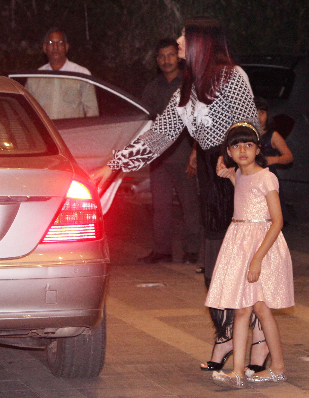 Aishwarya Rai and Aaradhya see off Brindya Rai outside the restaurant.