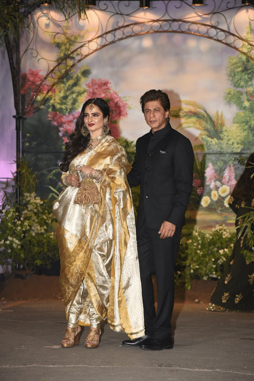 Bollywood Badshah Shah Rukh Khan with Rekha, who was sizzling in gold.