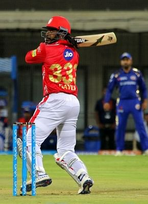 Indore: Chris Gayle of Kings XI Punjab in action during an IPL 2018 match between Kings XI Punjab and Mumbai Indians at Holkar Cricket Stadium in Indore on May 4, 20128. (Photo: Surjeet Yadav/IANS)