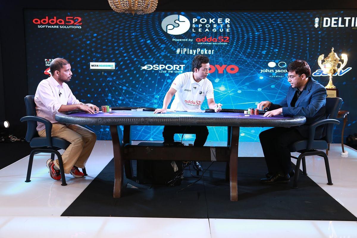 Chess champion Viswanathan Anand playing a few hands with IIM Kozhikode Associate Professor Deepak Dhayanithy.