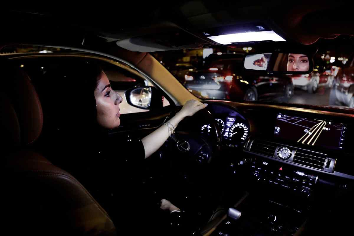 Saudi women take the driver's seat for the first time in the country, steering their way through busy city streets just minutes after the ban on women driving was lifted on Sunday.