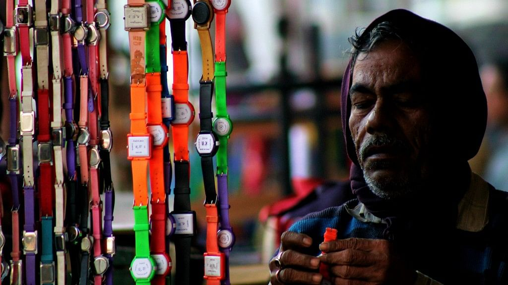 A watch seller sets up shop.