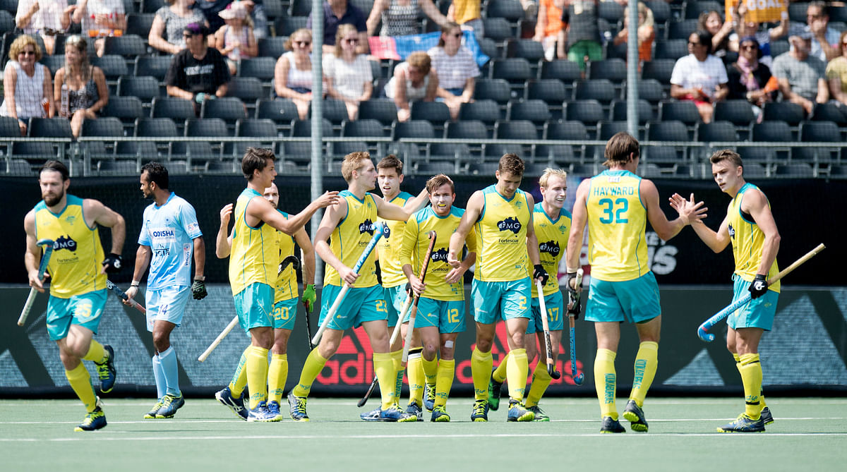The Australian team celebrate a goal.