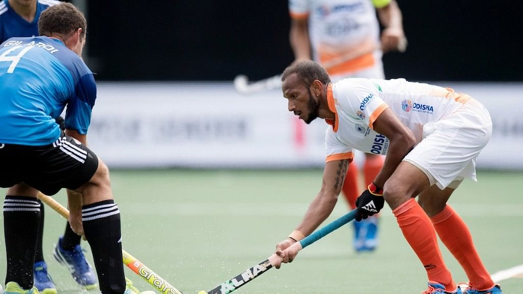 India's SV Sunil fights for the ball with an Argentine player in the dying minutes of the match.