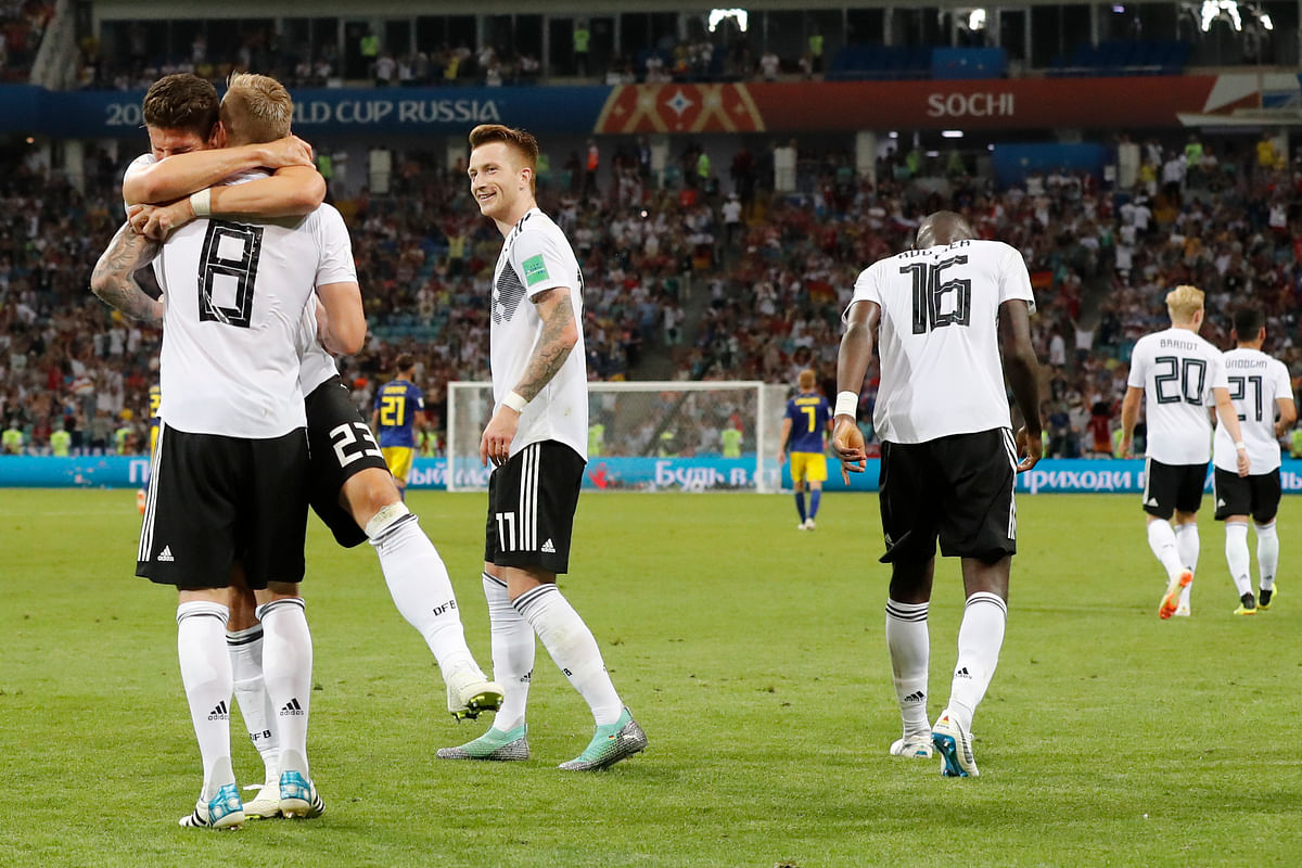 Germany's Toni Kroos,  celebrates with his teammates after he scored his side's second goal during the group F match between Germany and Sweden