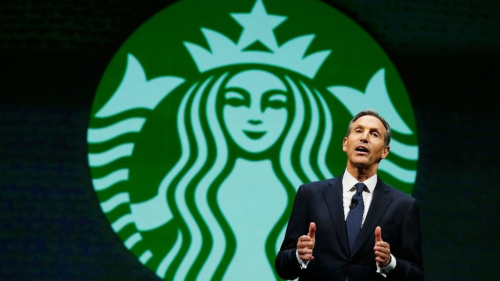 Starbucks CEO Howard Schultz speaks at the coffee company's annual shareholders meeting in Seattle.