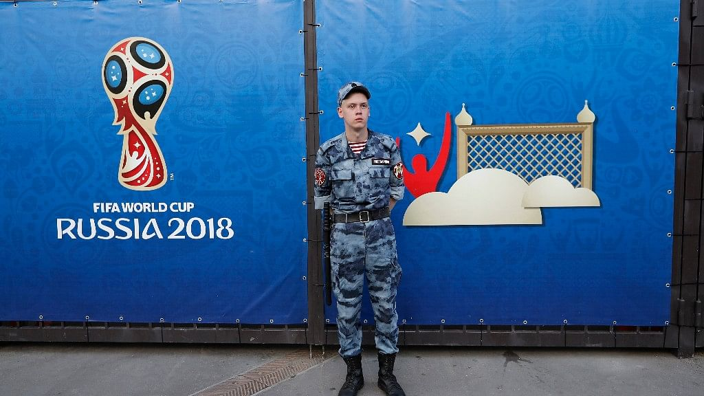 A Russian police officer guards an entrance ahead of the group F match between Germany and Mexico at the FIFA World Cup 2018