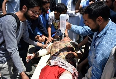 Shopian: An injured being taken to a hospital for treatment, in Jammu and Kashmir