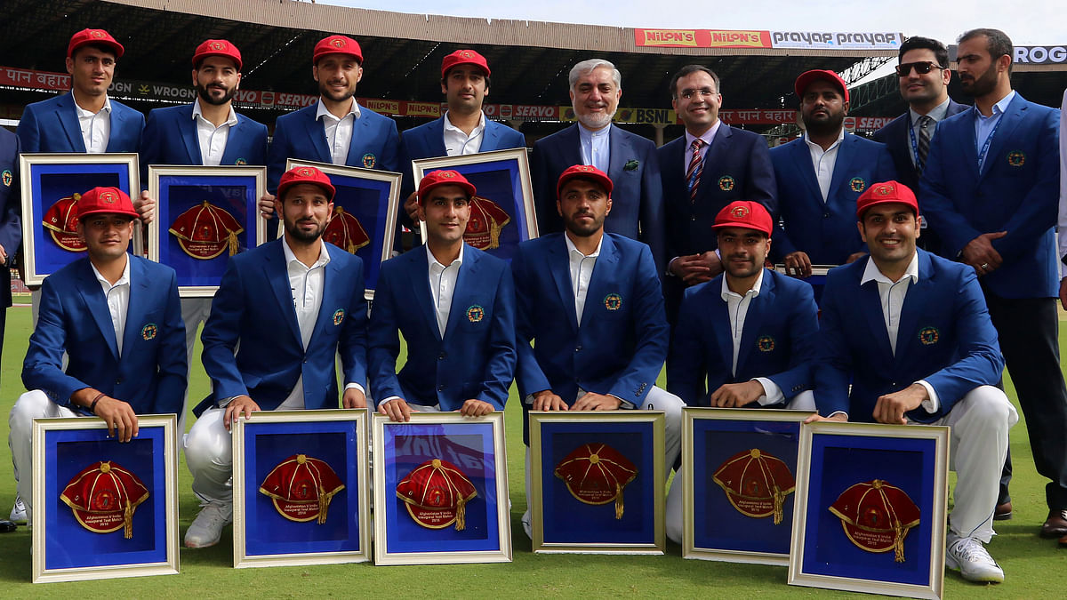 """<div class=""""paragraphs""""><p>Afghanistan pose with special caps after becoming a Test playing nation</p></div>"""