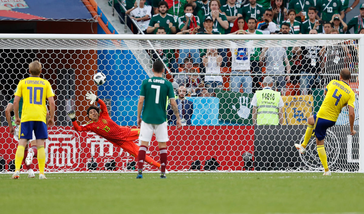 Sweden's Andreas Granqvist (right) puts in a penalty to score his side's second goal during their Group F match against Mexico at the  Yekaterinburg Arena on Wednesday.
