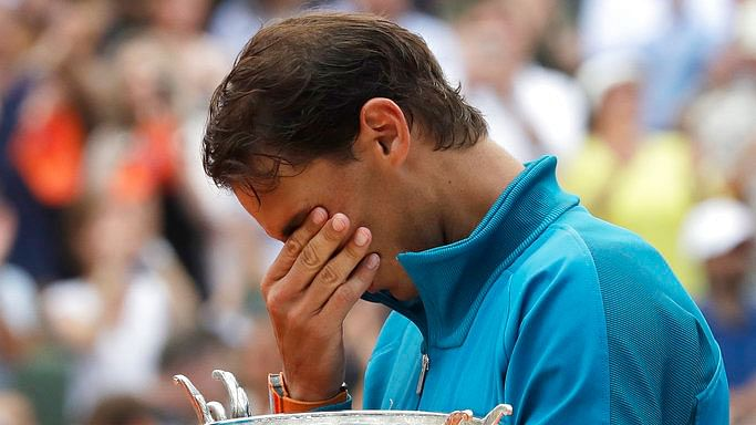 Rafael Nadal is overcome with emotion as he celebrates his 11th French Open title.