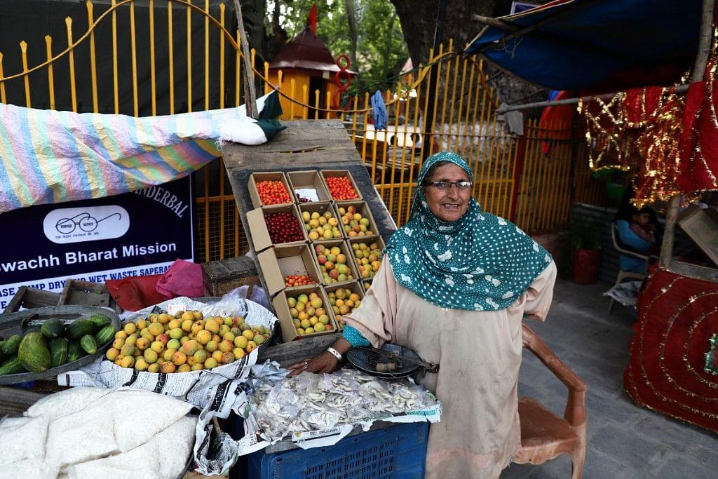 Azee Massowns a fruit stall.