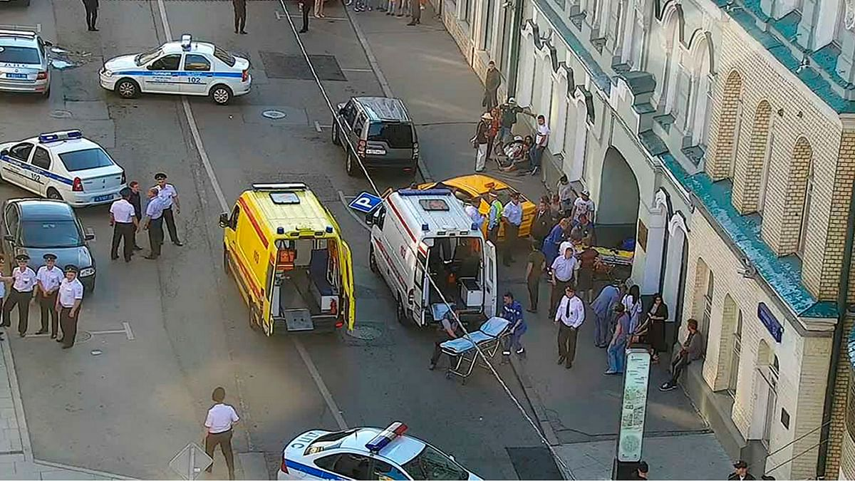Provided by Moscow Traffic Control Center Press Service, ambulance and police work at the site of an incident involving 8 injured