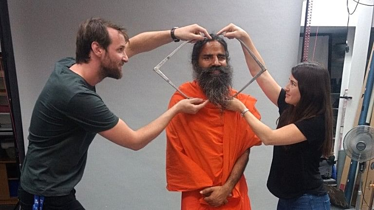 Yoga Guru Baba Ramdev giving measurements for his wax statue in London.