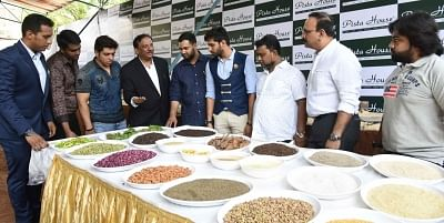 Majeed of Pista House (4th from left) showing ingredients of Haleem.