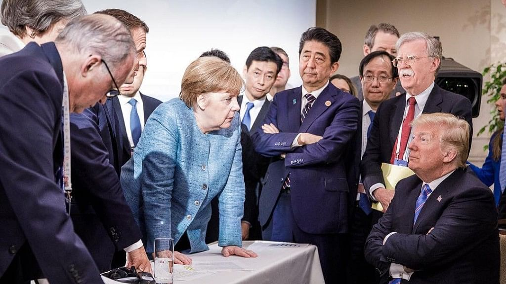 Photographer Jesco Denzel's snap at the G7 summit has captured the attention of the world.