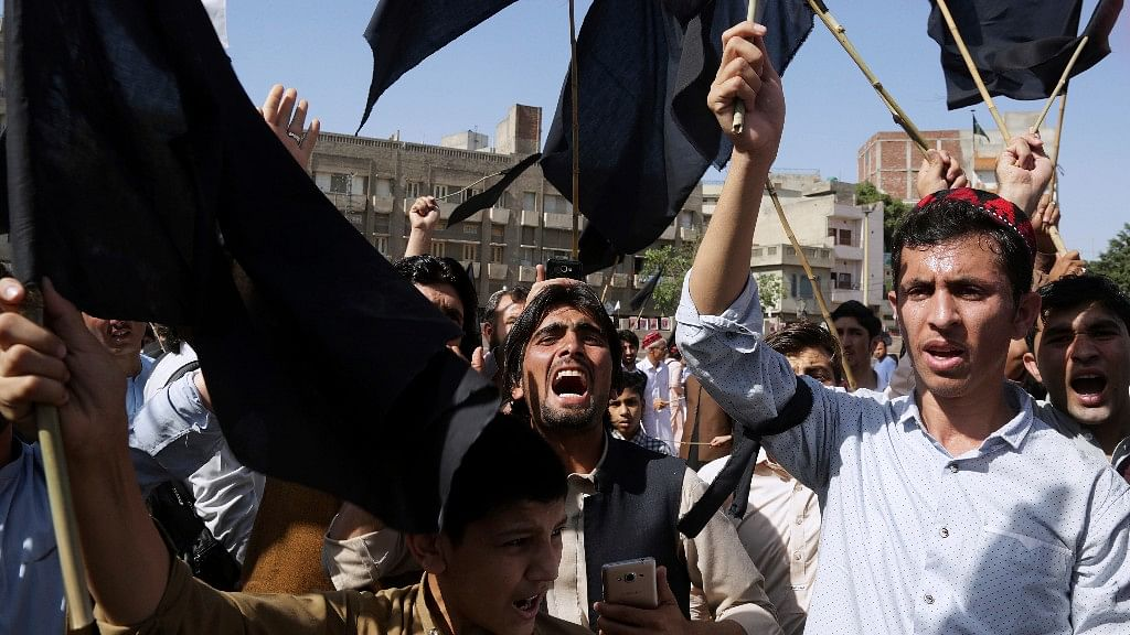 Supporters of Pashtun Protection Movement chant slogans during a rally in Lahore, Pakistan.