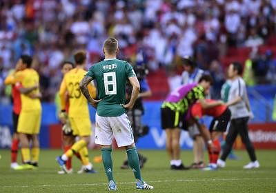 KAZAN, June 27, 2018 (Xinhua) -- Toni Kroos (front) of Germany reacts after the 2018 FIFA World Cup Group F match between Germany and South Korea in Kazan, Russia, June 27, 2018. South Korea won 2-0. (Xinhua/Chen Yichen/IANS)