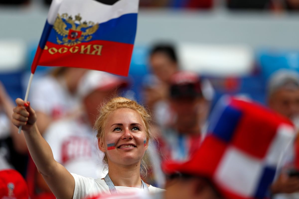 A fan waves a Russian flag ahead of the group A match between Uruguay and Russia at the FIFA World Cup 2018