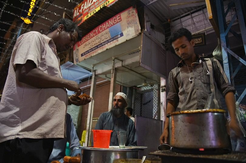 People wake up to have their pre-dawn meal called sehri