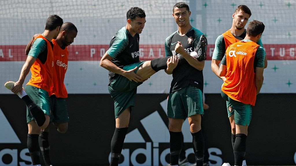 Portugal's Cristiano Ronaldo (right) stretches with teammate Pepe during their training session in Kratovo in the outskirts Moscow on Sunday.