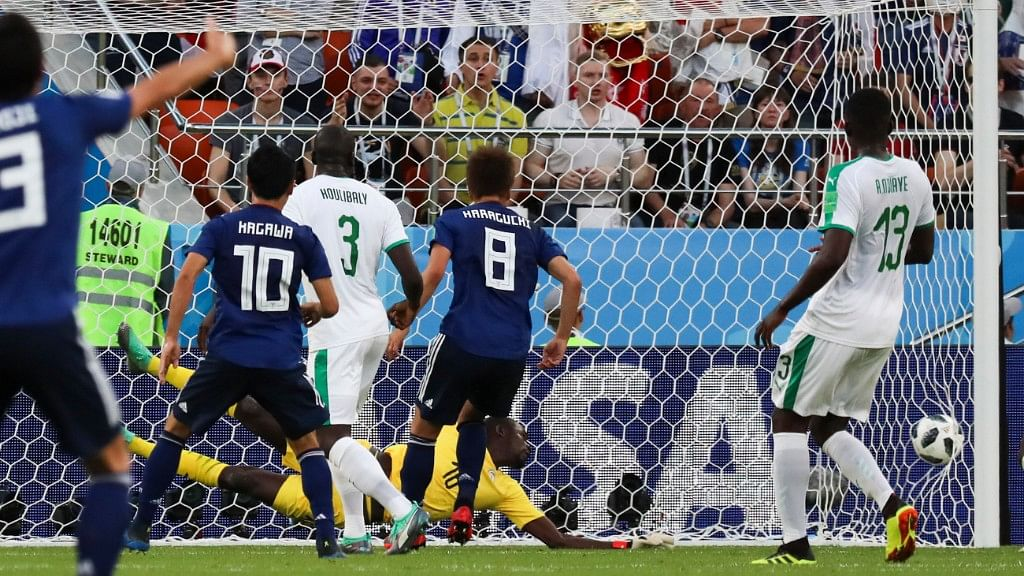 Senegal goalkeeper Khadim Ndiaye fails to stop a kick from Japan's Takashi Inui during their Group H match at the Yekaterinburg Arena on Sunday.