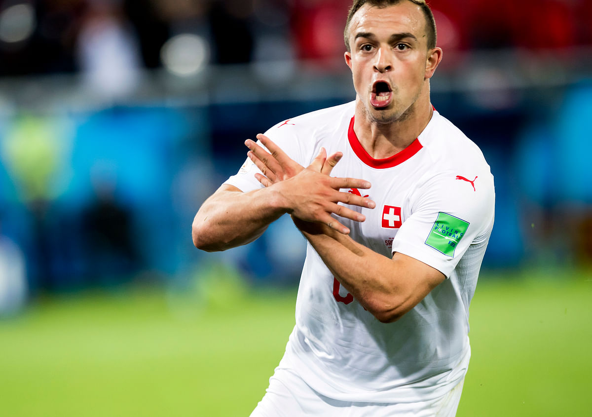 Switzerland's Xherdan Shaqiri celebrates after scoring his side's second goal during the between Switzerland and Serbia.