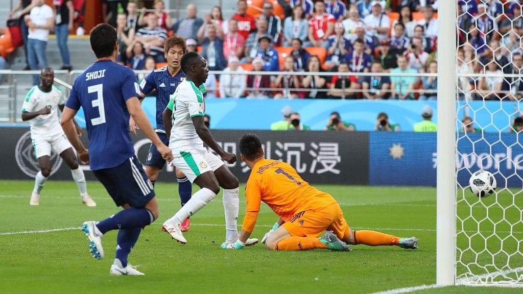 Senegal's Sadio Mane (centre) scores his side's opening goal past Japan goalkeeper Eiji Kawashima (right) during their Group H match at the Yekaterinburg Arena on Sunday.