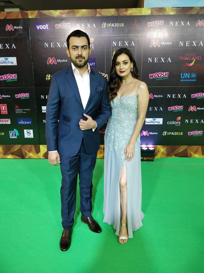 Dia Mirza looks stunning in a steel grey slit gown alongside husband, Sahil Sangha.
